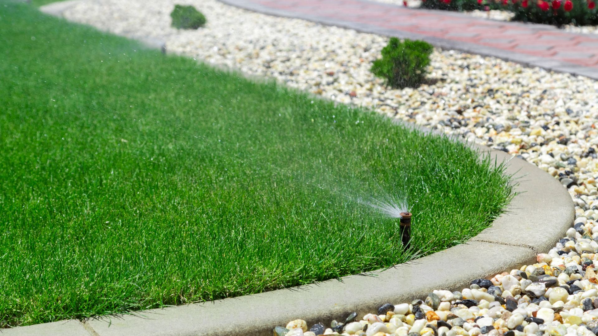 Irrigation system watering a home lawn.