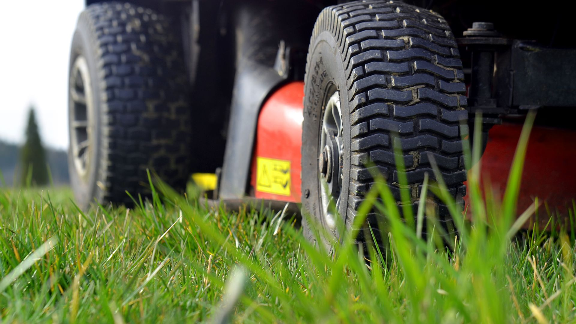 Close up of a lawnmower's tires in grass in Dewitt, MI.